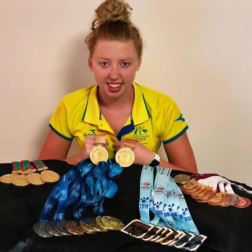 Lakeisha 'Lucky' Patterson, Paralympic gold medallist, displays her various swimming medals which includes two golds from Rio 2016