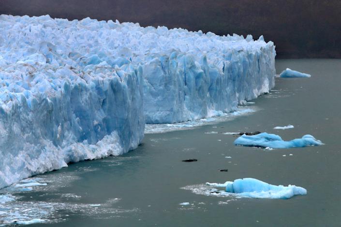 PERITO MORENO, ARGENTINA - APRIL 5: Broken ice floats in Lake Argentina below the cracked and creviced face of the Perito Moreno glacier, part of the Southern Patagonian Ice Field, in the Los Glaciares National Park on April 5, 2019 in Santa Cruz province, Argentina. The ice fields are the largest expanse of ice in the Southern Hemisphere outside of Antarctica but according to NASA, are melting away at some of the highest rates on the planet as a result of Global Warming. (Photo by David Silverman/Getty Images)
