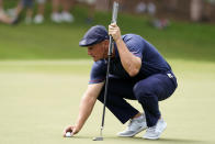 Bryson DeChambeau places his ball before putting on the second hole during second round play in the Tour Championship golf tournament at East Lake Golf Club, Friday, Sept. 3, 2021, in Atlanta. (AP Photo/Brynn Anderson)