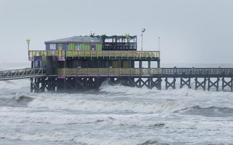 The Galveson Fishing Pier stands ahead of Hurricane Harvey in Galveston, Texa - Credit: F Carter Smith/Bloomberg