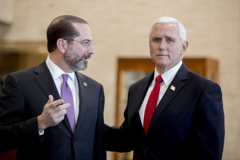 Vice President Mike Pence and Health and Human Services Secretary Alex Azar speak as Pence arrives for a coronavirus task force meeting at the Department of Health and Human Services, Thursday, Feb. 27, 2020, in Washington. (AP Photo/Andrew Harnik)