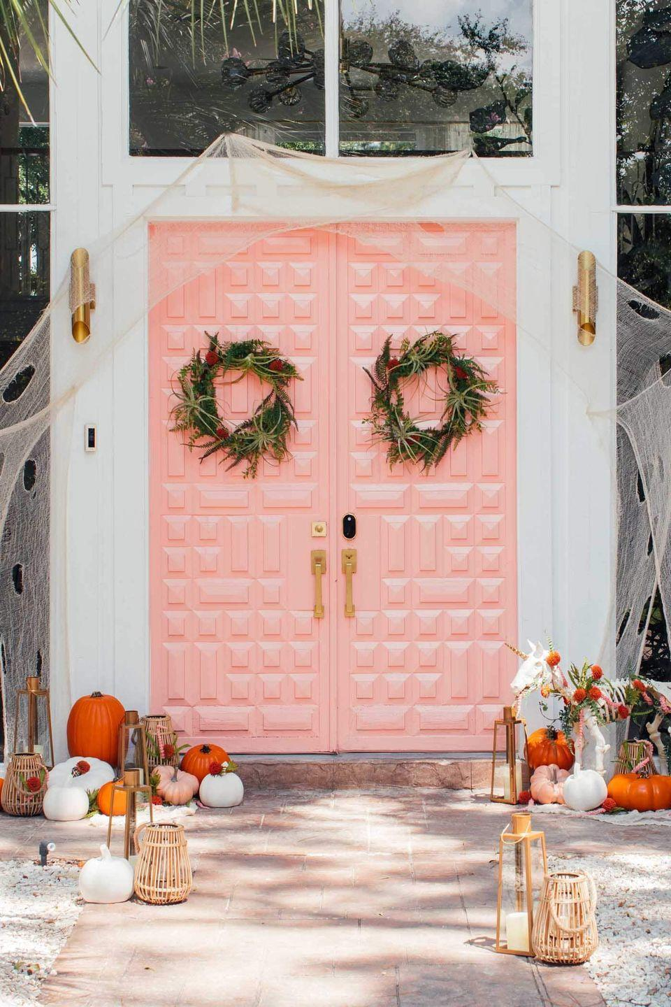 "<p>We adore everything about this blush-colored entryway display. But our favorite part is probably the unicorn skeleton in the corner. </p><p><em><a href=""https://sugarandcloth.com/halloween-door-decor-3-not-so-spooky-front-door-decor-ideas/"" rel=""nofollow noopener"" target=""_blank"" data-ylk=""slk:Get the tutorial at Sugar & Cloth »"" class=""link rapid-noclick-resp"">Get the tutorial at Sugar & Cloth »</a></em></p>"