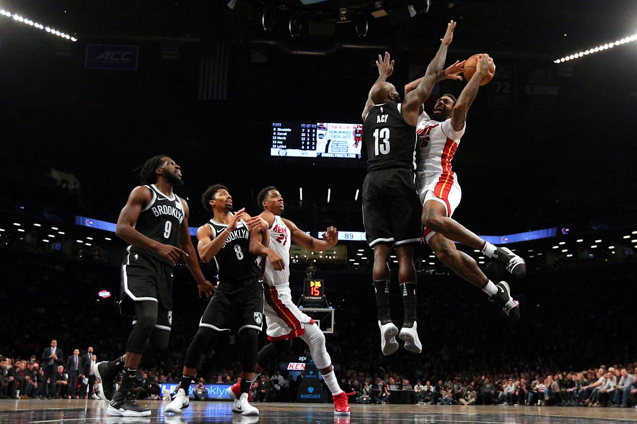 Jan 19, 2018; Brooklyn, NY, USA; Miami Heat power forward James Johnson (16) drives against Brooklyn Nets small forward Quincy Acy (13) during the fourth quarter at Barclays Center. Mandatory Credit: Brad Penner-USA TODAY Sports     TPX IMAGES OF THE DAY