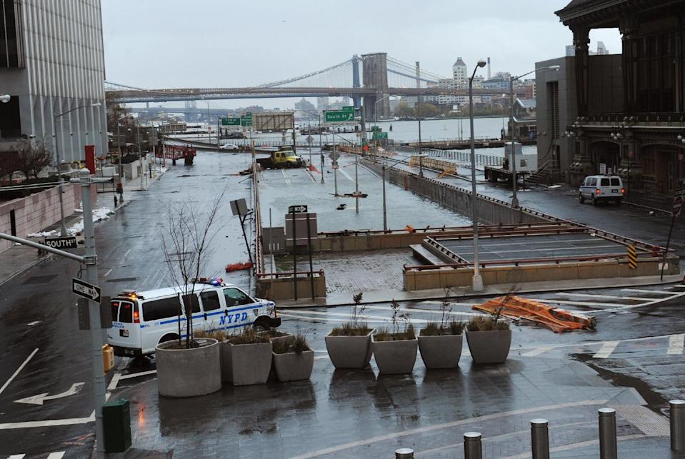 Water reaches the street level of the Battery Park Underpass, Tuesday, Oct. 30, 2012, in New York. Sandy arrived along the East Coast and morphed into a huge and problematic system, putting more than 7.5 million homes and businesses in the dark and causing a number of deaths. (AP Photo/Louis Lanzano)
