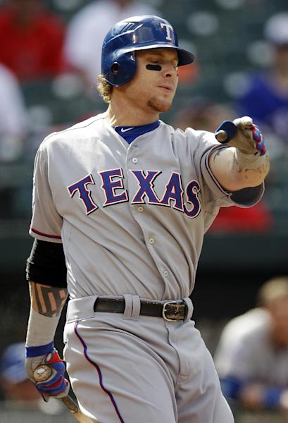 Texas Rangers' Josh Hamilton strikes out swinging to end the first inning of the first baseball game of a doubleheader against the Baltimore Orioles in Baltimore, Thursday, May 10, 2012. (AP Photo/Patrick Semansky)