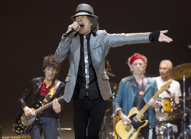 Mick Jagger, front center, Ronnie Wood, left, with Keith Richards and Charlie Watts, right, of The Rolling Stones, perform at the O2 arena in east London, Sunday, Nov. 25, 2012. The band are playing five gigs to celebrate their 50th anniversary, including two shows at London's O2 and three more in New York. (Photo by Joel Ryan/Invision/AP)