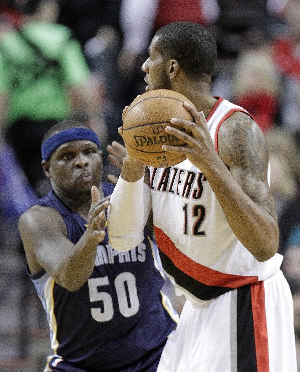 Portland Trail Blazers forward LaMarcus Aldridge, right, looks to pass as Memphis Grizzlies forward Zach Randolph defends during the first half of an NBA basketball game in Portland, Ore., Tuesday, Jan. 28, 2014. (AP Photo/Don Ryan)
