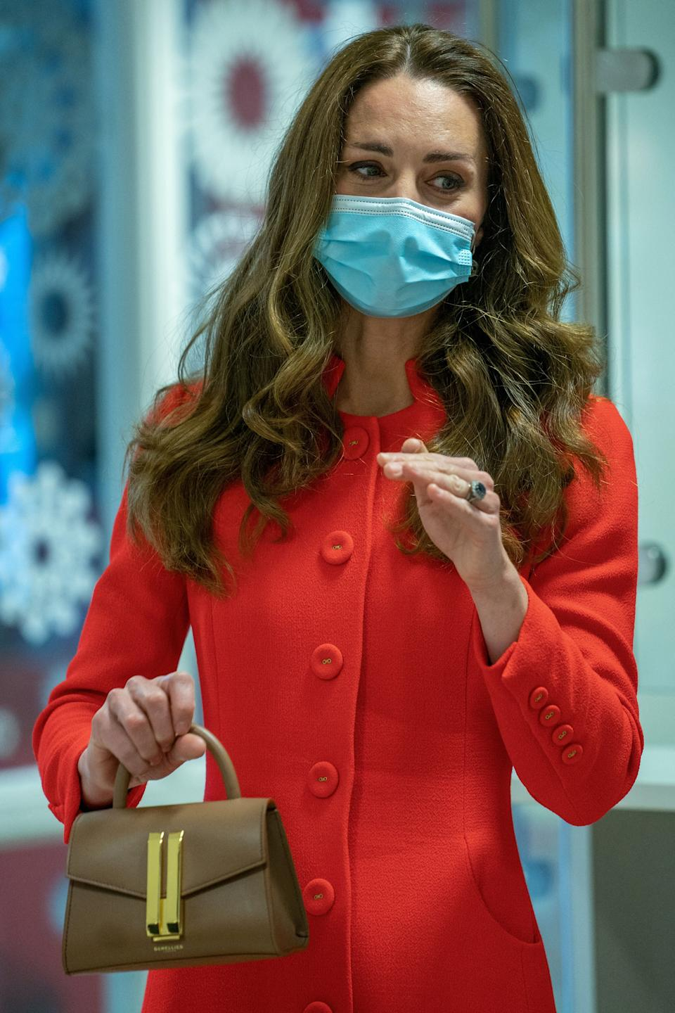 Britain's Catherine, Duchess of Cambridge gestures on arrival for a visit to meet staff and hear how the hospital uses art to benefit patients and staff, at Royal London Hospital Whitechapel in east London, on May 7 2021. (Photo by Arthur EDWARDS / various sources / AFP) (Photo by ARTHUR EDWARDS/AFP via Getty Images)