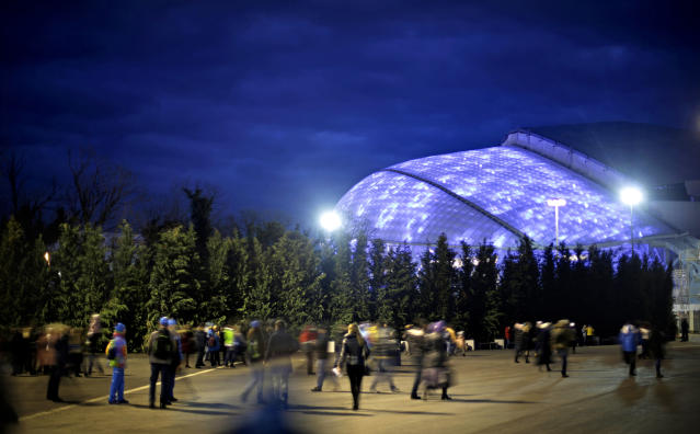 Spectators arrive for the rehearsal of the opening ceremony at the Fisht Olympic Stadium, rear, at the 2014 Winter Olympics, Saturday, Feb. 1, 2014, in Sochi, Russia. (AP Photo/David Goldman)