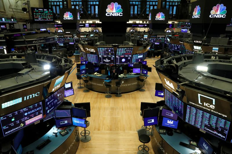 FILE PHOTO: Floor traders work space is seen on the trading floor after the closing bell, following traders positive for Coronavirus disease (COVID-19), at the NYSE in New York
