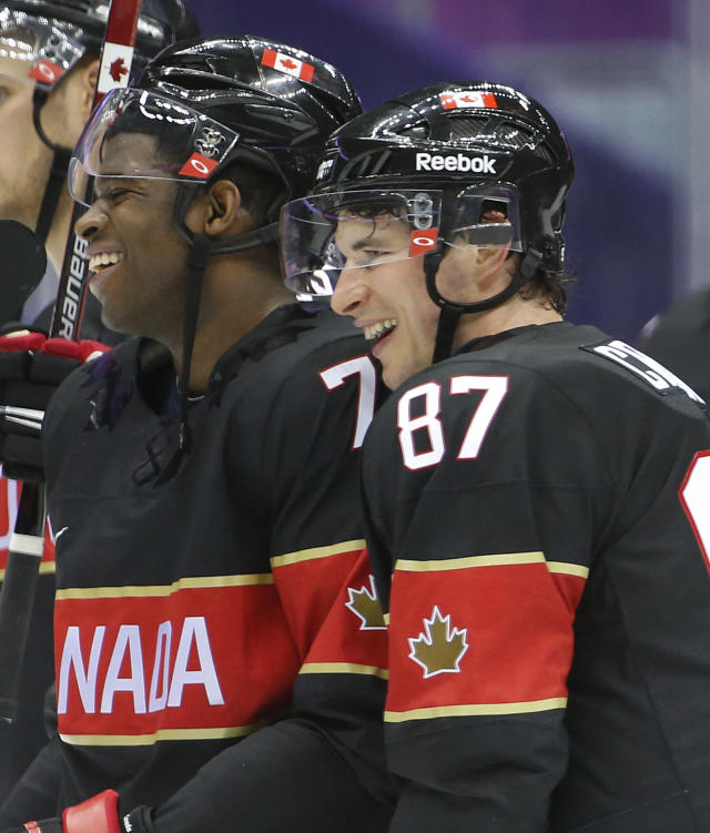 Canada defenseman P.K. Subban, left, and forward Sidney Crosby skate off the ice after beating Austria 6-0 in a men's ice hockey game at the 2014 Winter Olympics, Friday, Feb. 14, 2014, in Sochi, Russia. (AP Photo/Mark Humphrey)