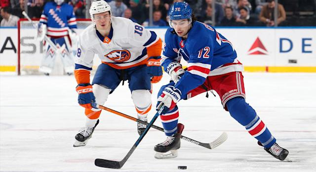 Filip Chytil #72 of the New York Rangers skates with the puck against Anthony Beauvillier #18 of the New York Islanders at Madison Square Garden on January 21, 2020 in New York City. (Photo by Jared Silber/NHLI via Getty Images)