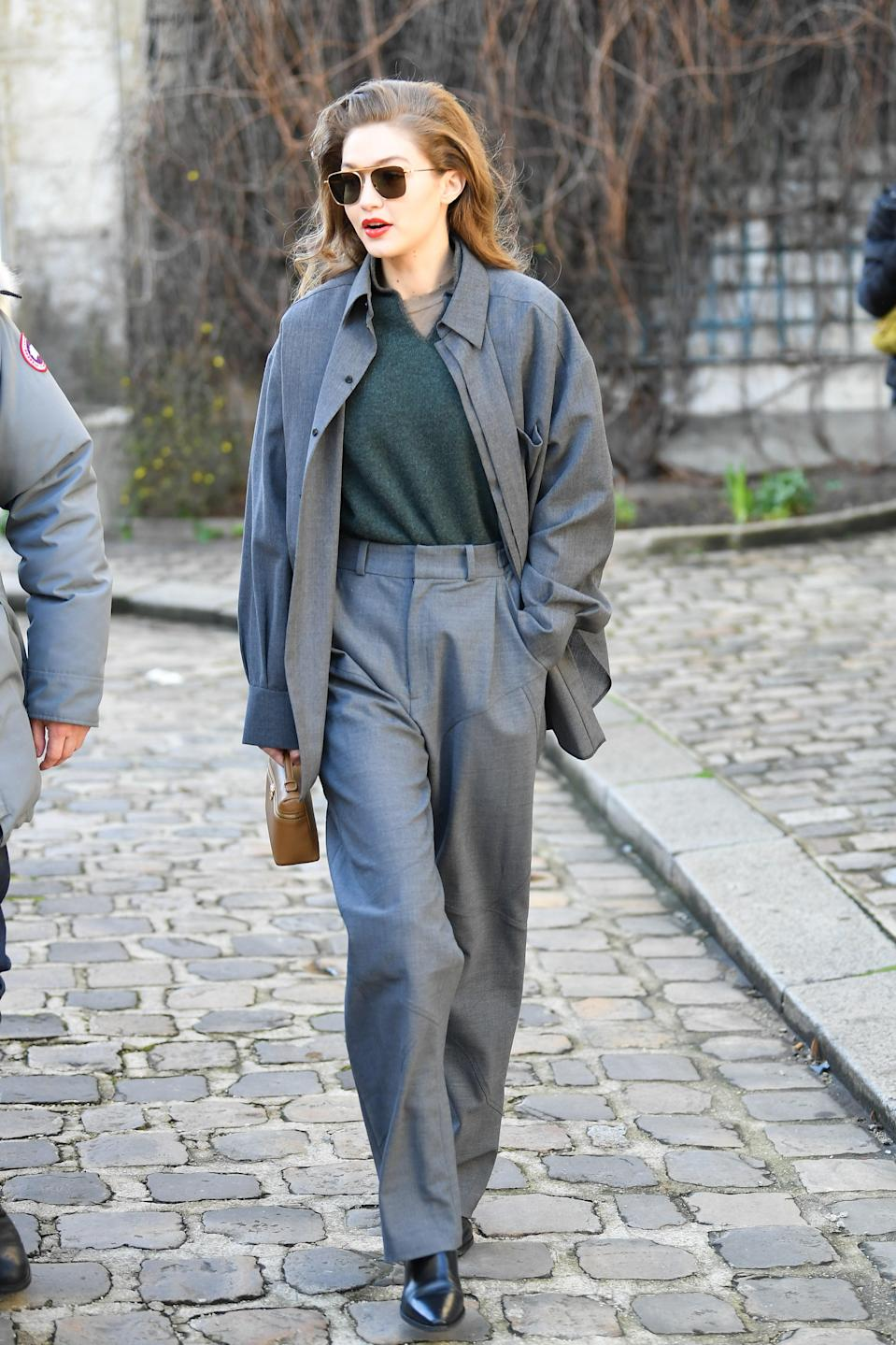 Another take on the silhouette play. For the Lanvin show, Gigi opted for grey. Instead of a tailored suit, she favored oversized proportions and this is perhaps one of her strongest street style looks to date. Elegant yet casual.