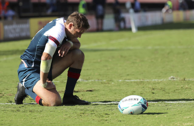 United States' AJ MacGinty reacts after a try by Argentina's Joaquin Tuculet during the Rugby World Cup Pool C game at Kumagaya Rugby Stadium between Argentina and the United States in Kumagaya City, Japan, Wednesday, Oct. 9, 2019. (AP Photo/Eugene Hoshiko)