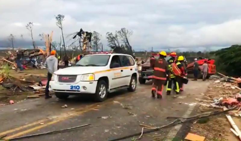 Emergency responders work in the scene amid debris in Lee County, Ala., after what appeared to be a tornado struck in the area, March 3, 2019. Severe storms destroyed mobile homes, snapped trees and left a trail of destruction amid weather warnings extending into Georgia, Florida and South Carolina, authorities said. (Photo: WKRG-TV via AP)