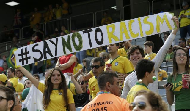 Fans hold up a banner before the 2014 World Cup Group B soccer match between Australia and Spain at the Baixada arena in Curitiba June 23, 2014. REUTERS/Henry Romero (BRAZIL - Tags: SOCCER SPORT WORLD CUP)