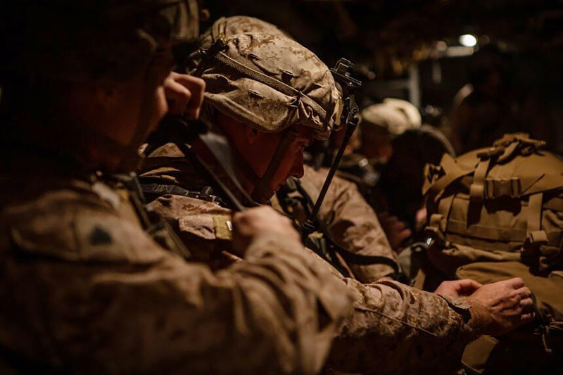 In this photo provided by U.S. Department of Defense, U.S. Marines assigned to Special Purpose Marine Air-Ground Task Force-Crisis Response-Central Command (SPMAGTF-CR-CC) 19.2, prepare to deploy from Kuwait in support of a crisis response mission, Tuesday, Dec. 31, 2019. The SPMAGTF-CR-CC is designed to move to support operations throughout the Middle East. (U.S. Marine Corps photos by Sgt. Robert G. Gavaldon via AP)
