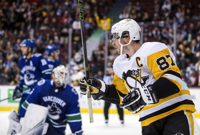 Pittsburgh Penguins' Sidney Crosby (87) celebrates his second goal against Vancouver Canucks goalie Jacob Markstrom, of Sweden, during the third period of an NHL hockey game, Saturday, Oct. 27, 2018, in Vancouver, British Columbia. (Darryl Dyck/The Canadian Press via AP)