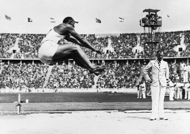(Original Caption) 8/8/1936-Berlin, Germany- Jesse Owens soars through the air with the greatest of ease for a distance of 26 feet 5-221/64 inches, bettering the Olympic mark, and winning the event at the games in Berlin. (Photo: Bettmann via Getty Images)