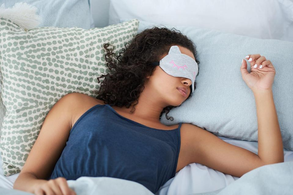 Shot of an attractive young woman sleeping in bed with an eye mask during the morning