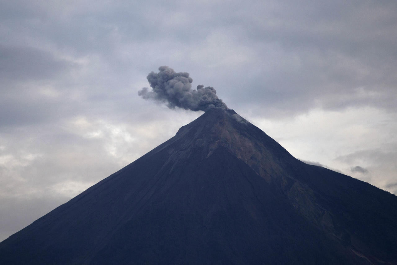 "<p>The Volcan de Fuego, or ""Volcano of Fire,"" blows a cloud of ash in Escuintla, Guatemala, Thursday, June 7, 2018. (Photo: Moisés Castillo/AP) </p>"