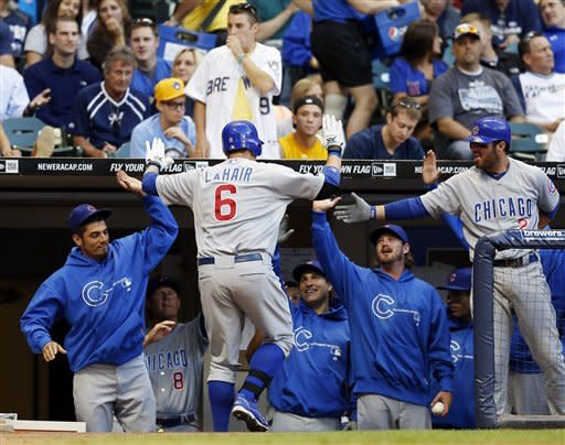 Chicago Cubs' Bryan LaHair is greeted by teammates after hitting a home run in the fourth inning of a baseball game against the Milwaukee Brewers, Tuesday, June 5, 2012, in Milwaukee. (AP Photo/Tom Lynn)