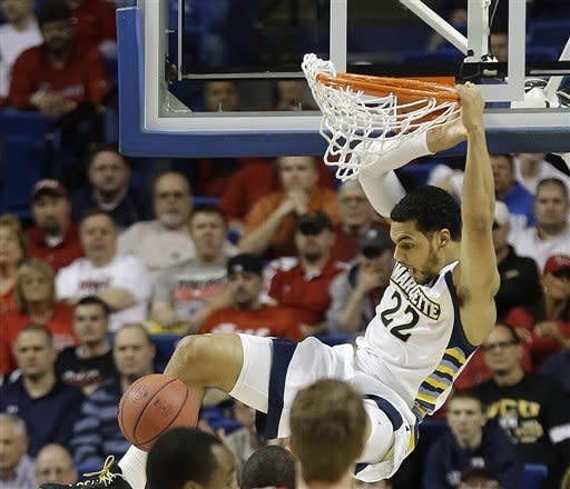 Marquette guard Trent Lockett (22) scores during the first half of a second-round game in the NCAA college basketball tournament against Davidson Thursday, March 21, 2013, in Lexington, Ky. (AP Photo/John Bazemore)