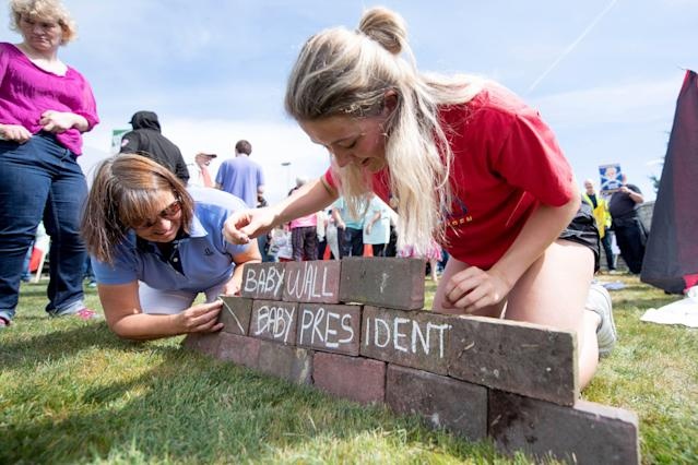 """<p>Protesters against the U.K. visit of President Trump build a """"baby wall"""" outside his golf course, Trump International Golf Links near Aberdeen, Scotland, on July 14, 2018, during the private part of his four-day U.K. visit. (Photo: Michal Wachucik/AFP/Getty Images) </p>"""
