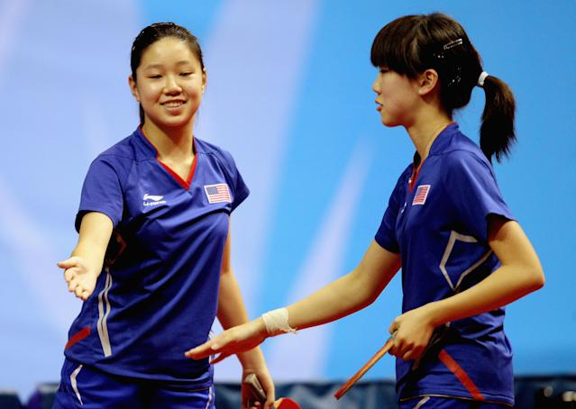 GUADALAJARA, MEXICO - OCTOBER 15: Erica Wu (R) and Lily Zhang of USA celebrate after their doubles victory during the Women's Table Tennis during Day One of the XVI Pan American Games at Code Dome on October 15, 2011 in Guadalajara, Mexico. (Photo by Scott Heavey/Getty Images)