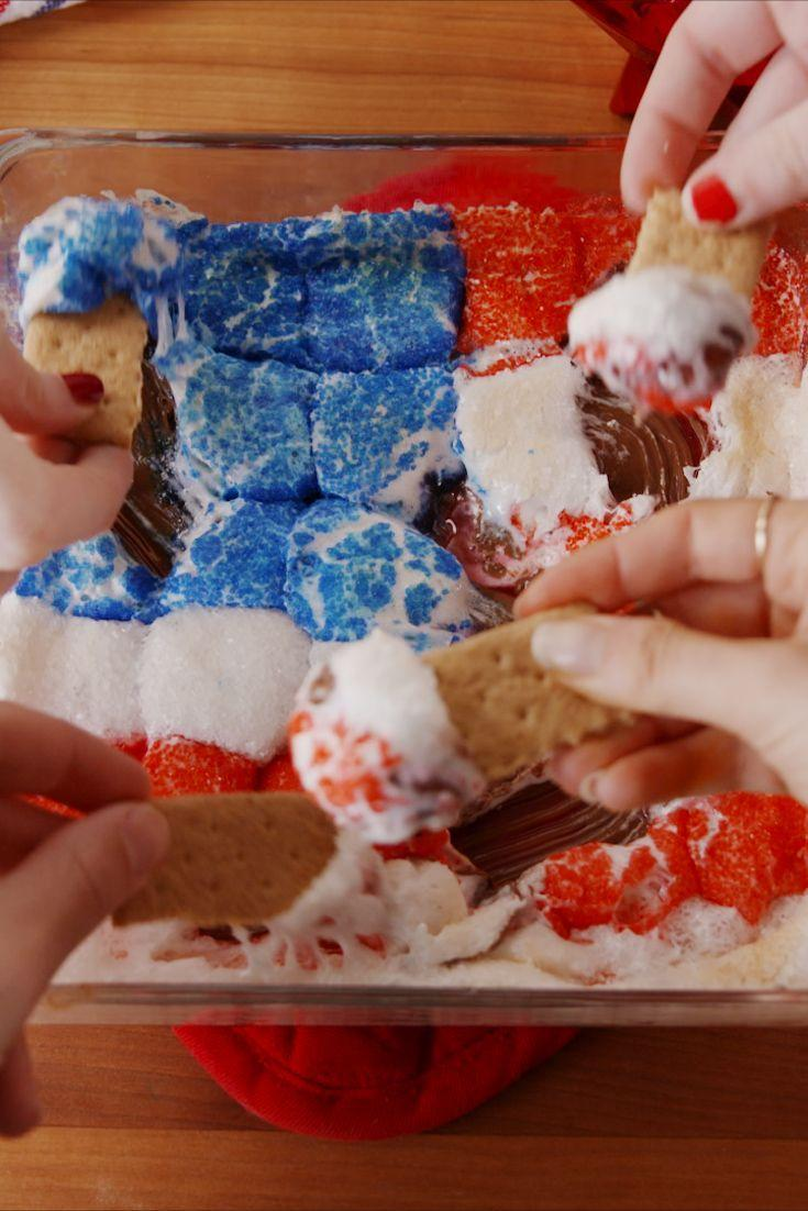 "<p>This is SO fun.</p><p>Get the recipe from <a href=""https://www.delish.com/cooking/recipe-ideas/recipes/a53914/july-4th-smores-dip-recipe/"" rel=""nofollow noopener"" target=""_blank"" data-ylk=""slk:Delish"" class=""link rapid-noclick-resp"">Delish</a>.</p>"