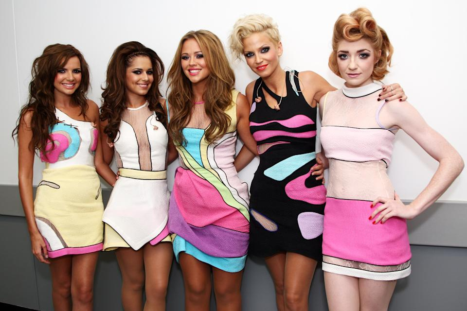 Nadine Coyle, Cheryl Cole, Kimberley Walsh, Sarah Harding and Nicola Roberts of Girls Aloud pose backstage at Wembley Stadium before performing as part of Coldplay's Viva La Vida tour at Wembley Stadium on September 19, 2009 in London, England. (Photo by Dave Hogan/Girls Aloud/Getty Images)