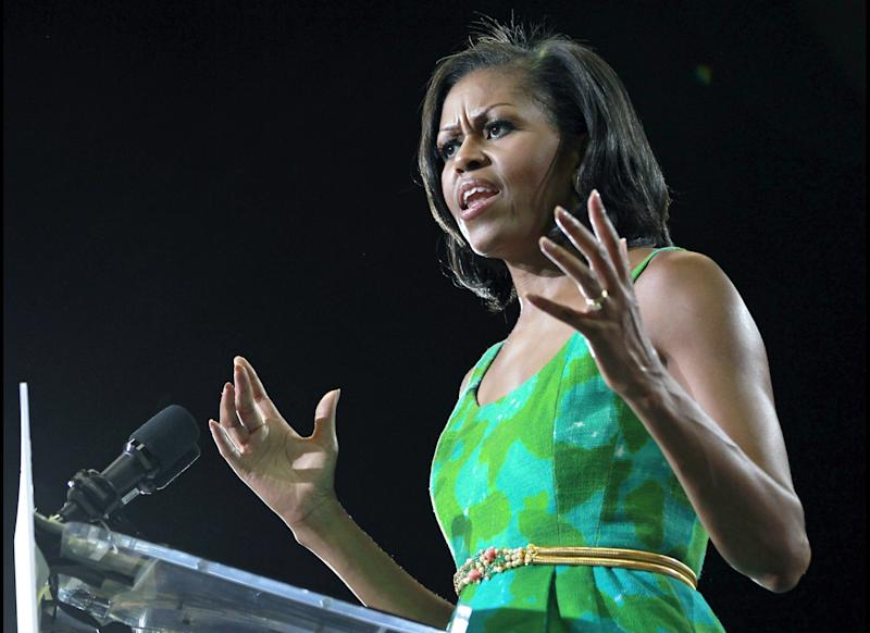 First lady Michelle Obama speaks to supporters during a campaign event for her husband, President Barack Obama at the University of Central Florida, Tuesday, July 10, 2012, in Orlando, Fla.