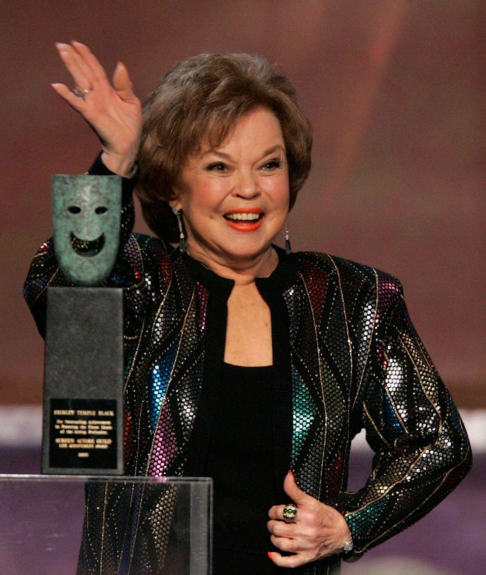 <p>Shirley Temple Black waves to the audience at the 12th Annual Screen Actors Guild Awards where she was presented the Life Achievement Award.</p>