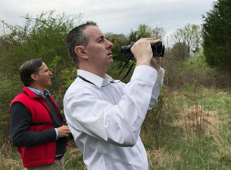 U.S. Rep. Brian Fitzpatrick with Greg Goldman executive director of Audubon Pennsylvania tries to spot a red-winged blackbird in New Hope