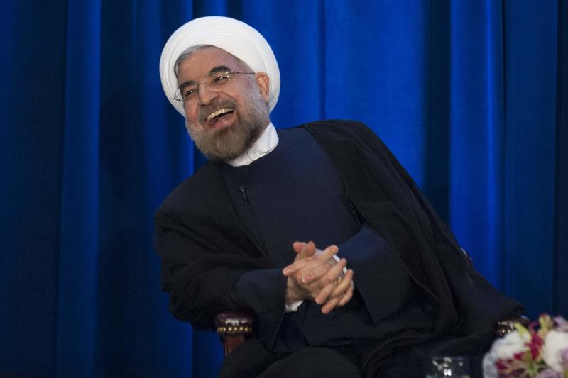 Iran's President Hassan Rohani laughs as he speaks during an event hosted by the Council on Foreign Relations and the Asia Society in New York, September 26, 2013. REUTERS/Keith Bedford (UNITED STATES - Tags: POLITICS)