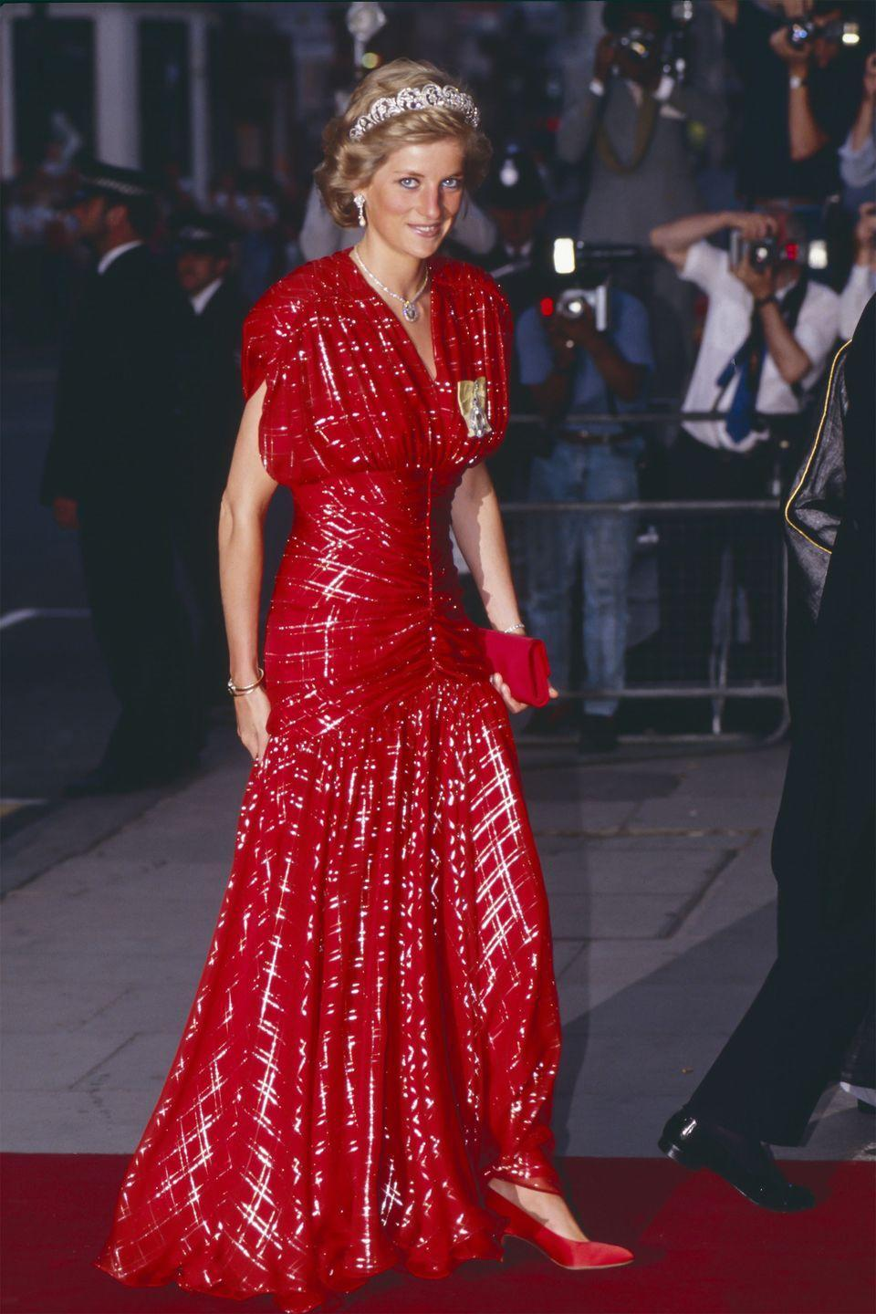 <p>In a red gown with matching clutch and shoes arriving at Claridge's Hotel in London. </p>