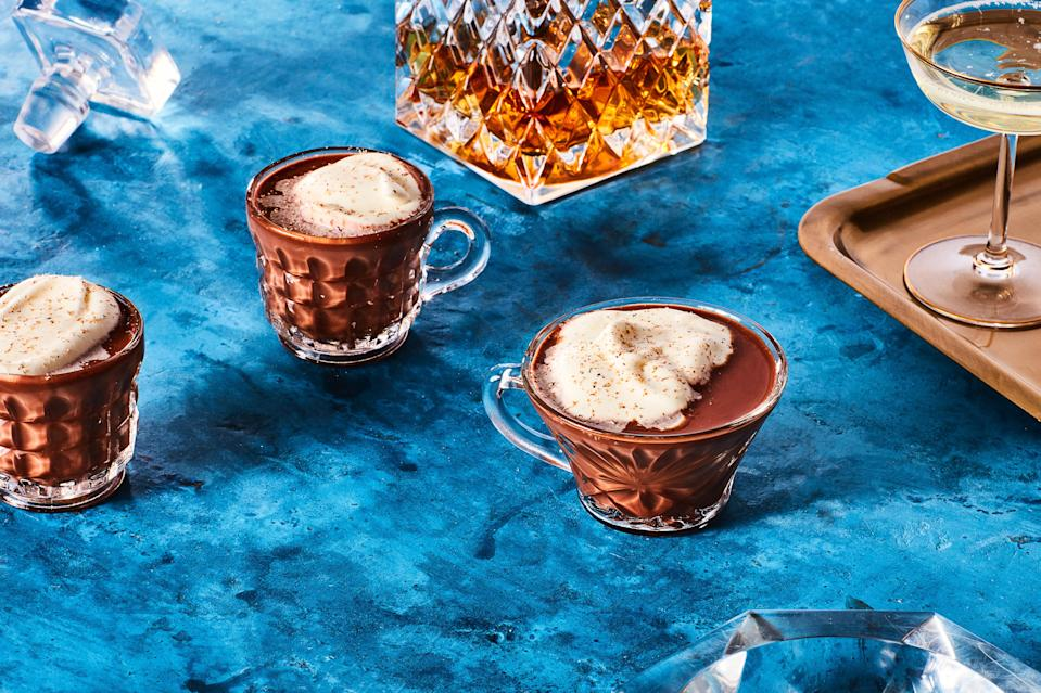 """Butter adds velvety texture and comforting flavor to this warming cocktail. Omit the rum and it's an equally delicious alcohol-free treat for anyone to enjoy. <a href=""""https://www.epicurious.com/recipes/food/views/buttered-rum-hot-chocolate?mbid=synd_yahoo_rss"""" rel=""""nofollow noopener"""" target=""""_blank"""" data-ylk=""""slk:See recipe."""" class=""""link rapid-noclick-resp"""">See recipe.</a>"""
