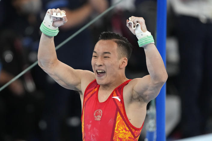 Xiao Ruoteng, of China, celebrates after performing on the horizontal bar during the artistic gymnastics men's all-around final at the 2020 Summer Olympics, Wednesday, July 28, 2021, in Tokyo. Wei won the silver medal. (AP Photo/Gregory Bull)
