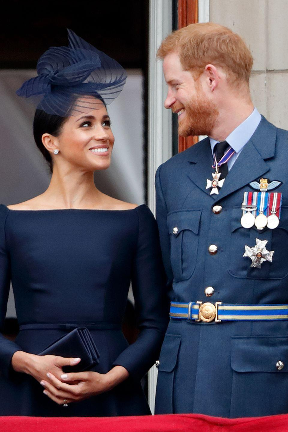 <p>The duke and duchess watch a flypast to mark the centenary of the Royal Air Force from the balcony of Buckingham Palace.</p>