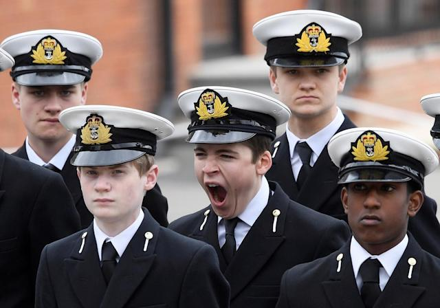 <p>A pupil yawns as he waits for Britain's Queen Elizabeth and Prince Philip to visit the Pangbourne College near Reading, May 9, 2017. (Photo: Toby Melville/Reuters) </p>