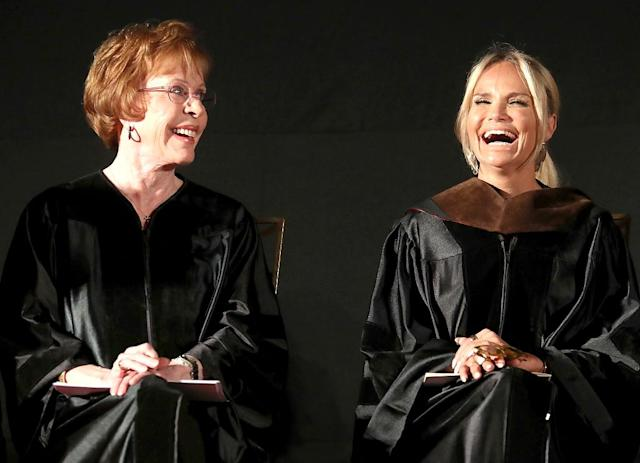 <p>The two shared a laugh at AFI Conservatory's 2017 Commencement in Hollywood, where Chenoweth presented Burnett with an honorary degree. Naturally, Burnett offered her signature Tarzan yell while accepting. (Photo: Frederick M. Brown/Getty Images for AFI) </p>