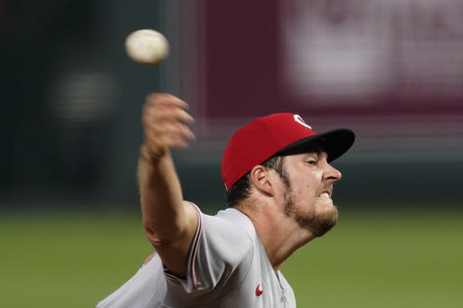 Cincinnati Reds starting pitcher Trevor Bauer throws during the seventh inning of game two of a baseball doubleheader against the Kansas City Royals Wednesday, Aug. 19, 2020, in Kansas City, Mo. The Reds won 5-0. (AP Photo/Charlie Riedel)