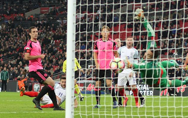 <span>Scotland lost their last World Cup qualifier 3-0 against England at Wembley</span> <span>Credit: Rex Features </span>