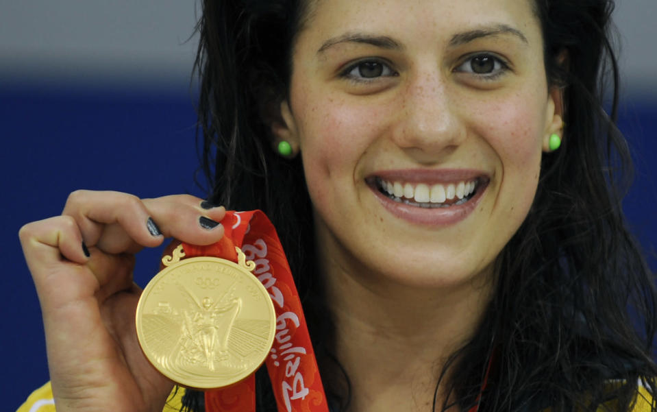 In a file picture taken on August 10, 2008 Australia's Stephanie Rice holds her medal after the women's 400m individual medley swimming final at the National Aquatics Center during the 2008 Beijing Olympic Games in Beijing. (TIMOTHY CLARY/AFP/Getty Images)