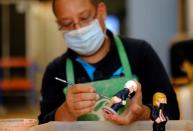 """A worker paints a U.S. Democratic presidential candidate Biden """"caganer"""", in a pottery in Torroella de Montgri"""