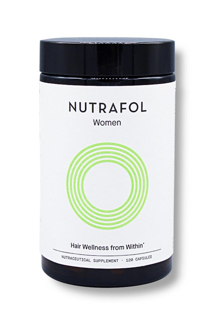 """<p>nutrafol.com</p><p><strong>$88.00</strong></p><p><a href=""""https://go.redirectingat.com?id=74968X1596630&url=https%3A%2F%2Fnutrafol.com%2Fnutrafol-core-for-women%2F%3Fgclid%3DCj0KCQiAqNPyBRCjARIsAKA-WFyDY9sz6o8FDDAKQ018dh148xY-dkrw3NTC8mQKqryEa4HKcawLLlkaAuTuEALw_wcB&sref=https%3A%2F%2Fwww.elle.com%2Fbeauty%2Fg31099887%2Fbest-hair-growth-vitamins%2F"""" rel=""""nofollow noopener"""" target=""""_blank"""" data-ylk=""""slk:Shop Now"""" class=""""link rapid-noclick-resp"""">Shop Now</a></p><p>A cult favorite, Nutrafol has received thousands of reviews from users online for its effective stress adaptogens, DHT inhibitors and super antioxidants. Formulated by physicians, these supplements are 100% drug free and are easily ordered through a monthly subscription. </p>"""