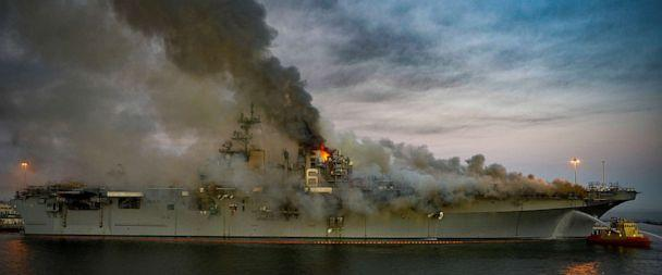 PHOTO: In this July 12, 2020, file photo, boats combat a fire on board the U.S. Navy amphibious assault ship USS Bonhomme Richard at Naval Base San Diego. (US Navy via Reuters, FILE)