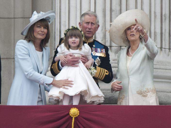 Prince Charles and Camilla on the balcony of Buckingham Palace with Camilla's granddaughter