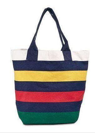 """This sturdy tote is at a great price and sports the classic HBC blanket-stripe colours that go with everything. If you&rsquo;re in an exchange with a low price limit, this gift is great on its own. <a href=""""http://www.thebay.com/webapp/wcs/stores/servlet/en/thebay/canvas-tote-bag-0038-hbcs14au031--24"""" target=""""_blank"""">Get it here.</a>"""