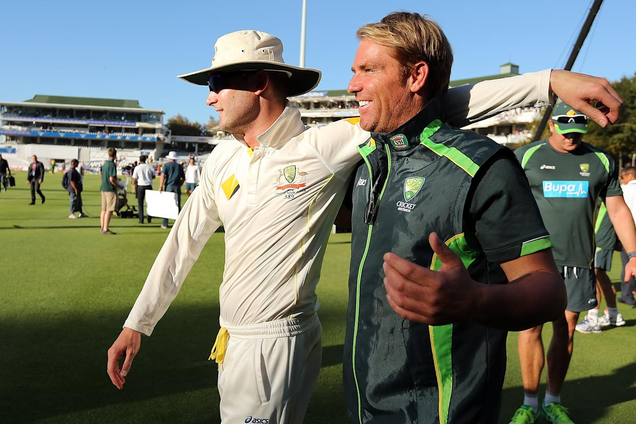 CAPE TOWN, SOUTH AFRICA - MARCH 05: Michael Clarke and Shane Warne of Australia celebrates after the game during day 5 of the third test match between South Africa and Australia at Sahara Park Newlands on March 5, 2014 in Cape Town, South Africa.  (Photo by Morne de Klerk/Getty Images)